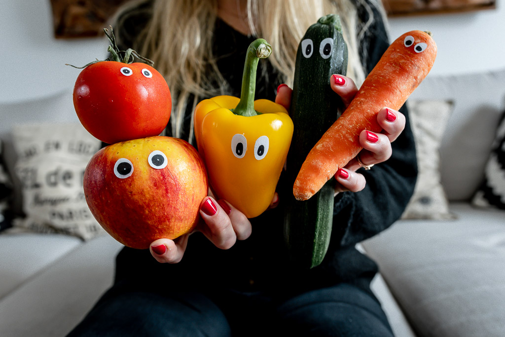 Tomato, apple, carrot, pepper with eyes looking like animals. Regional seasonal and organic vegetables to protect the climate.
