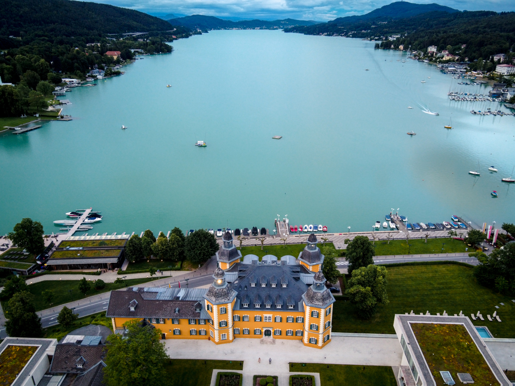 Lake Wörthersee from above, in front the Castle Hotel Schlosshotel Velden