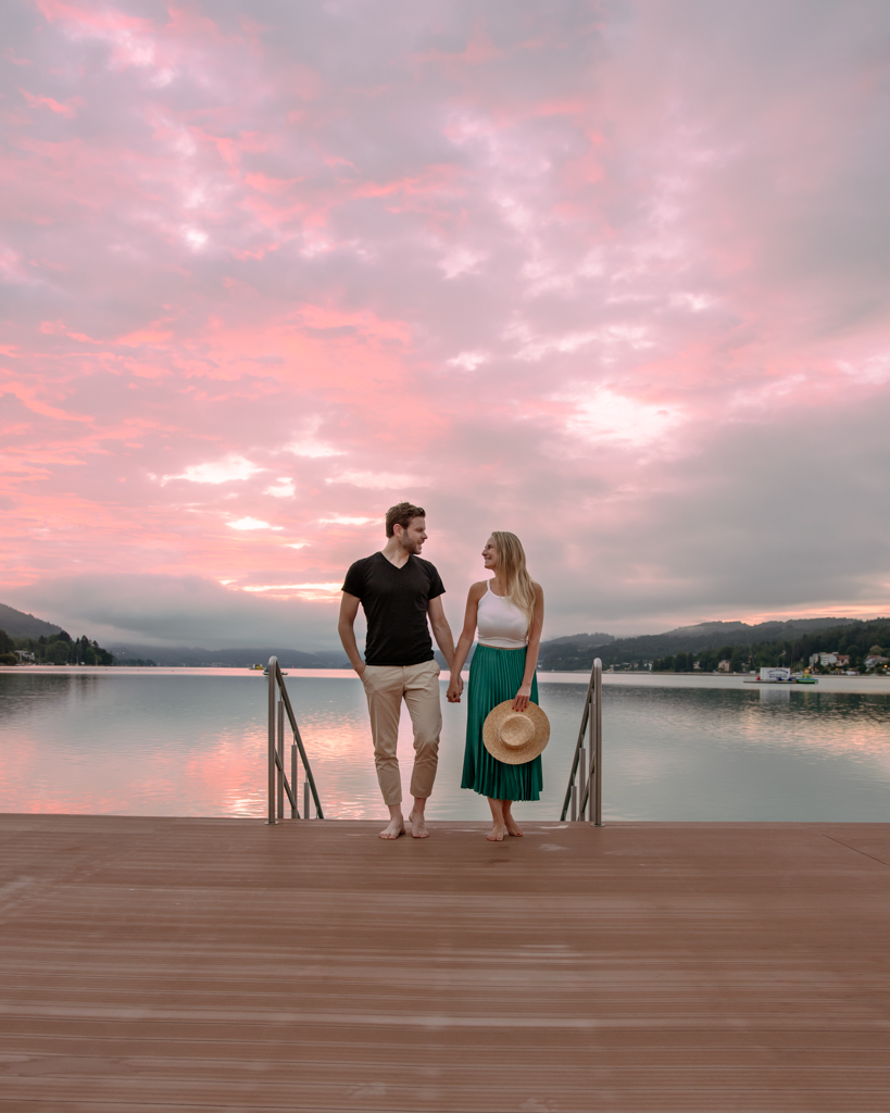 couple at the dock of Lake Wörthersee looking at each other