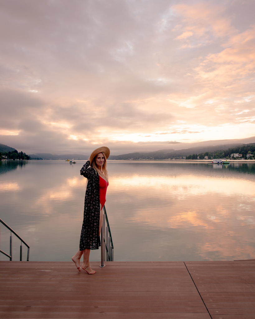 Girl standing at a Lake while visit Wörthersee in a swimsuit