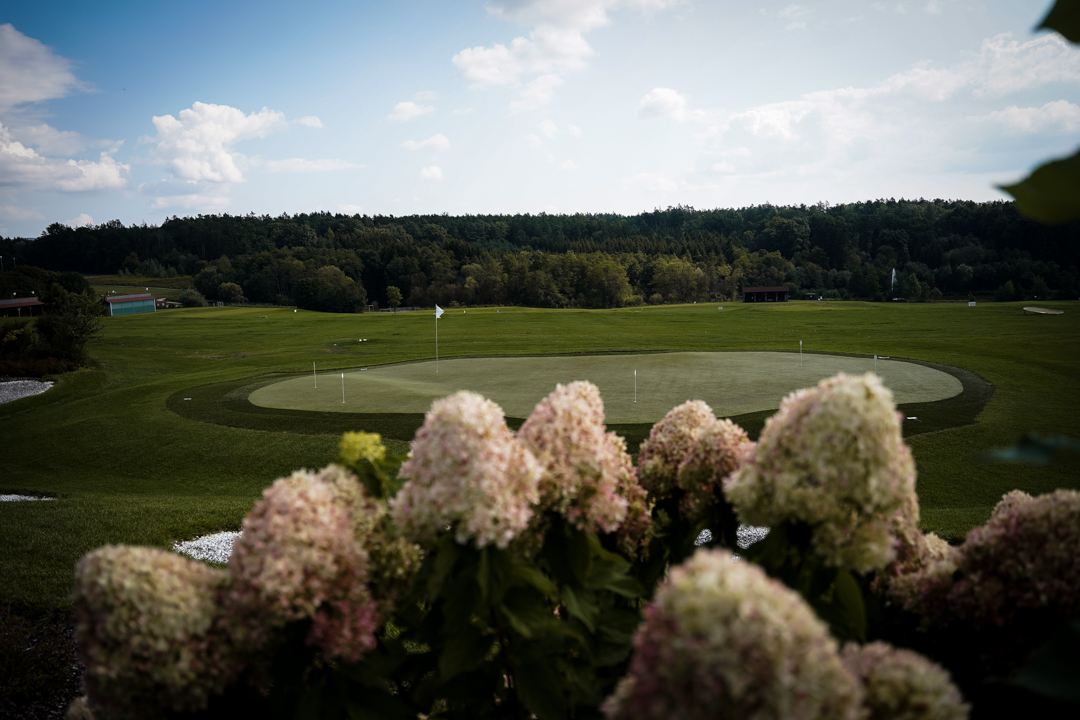 Golf course view with flowers in front