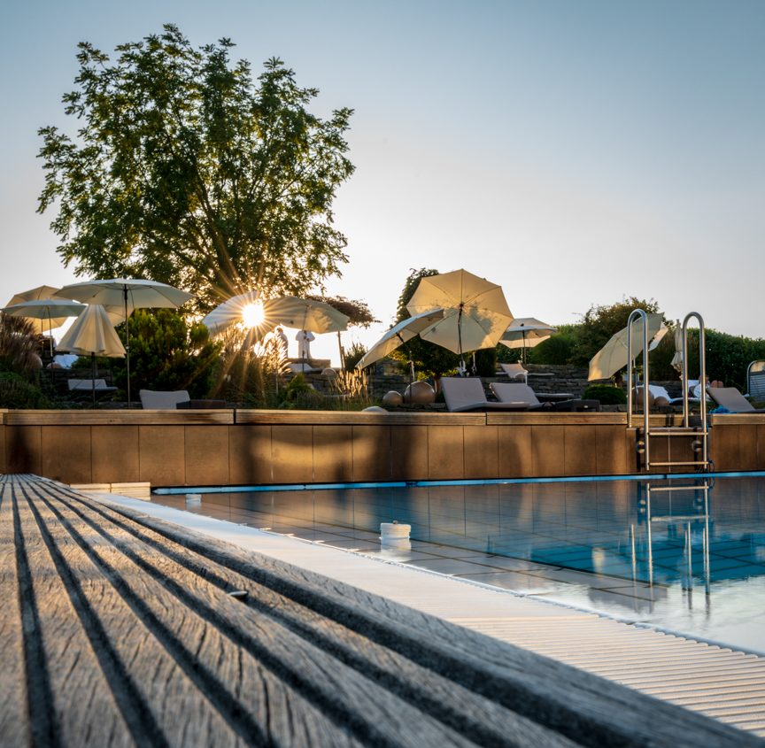 pool view and sun umbrellas of Reiters Reserve Supreme
