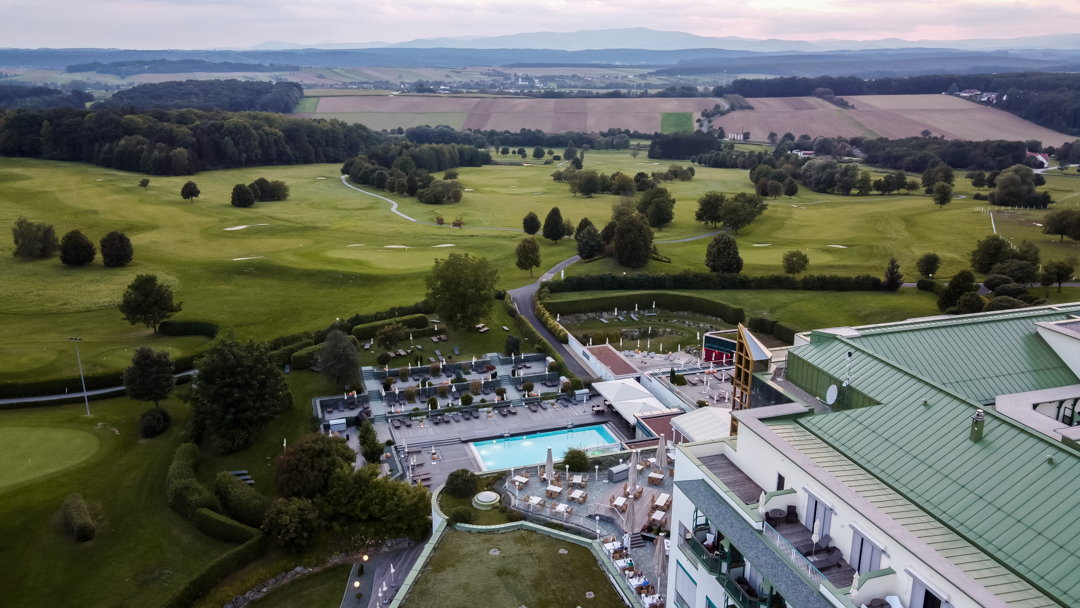 Drone shot of the Hotel with pool and golf course view